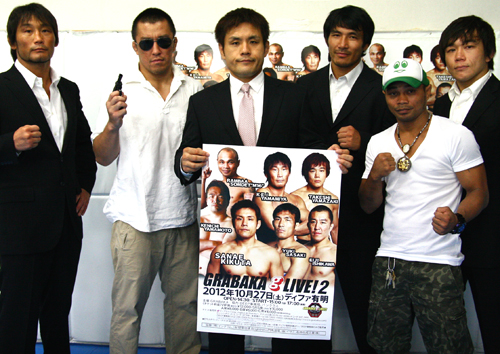 At the press conference held at GRBAKA gym in Nakano, Sanae Kikuta (middle - holding poster) announced second GRBAKA show. Other GRABAKA fighters (left to right: KEI Yamamiya, Eiji Ishikawa, Yuki Sasaki, Rambaa Somdet and Takeshi Yamazaki) were also present. *Somdet does not belong to GRABAKA.