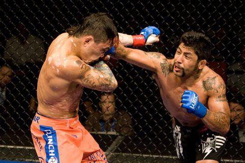 Antonio Banuelos striking with Scott Jorgensen