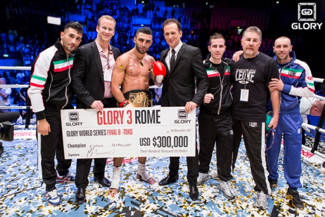 Petrosyan, with the GLORY tournament championship belt wrapped around his waist, took home a tournament grand prize of $300,000. The winner's check was presented to him by GLORY chairman Pierre Andurand (left of Petrosyan) and GLORY Managing Director Marcus Luer (right of Petrosyan.