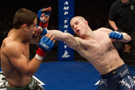 Erik Koch throwing a hook against Chad Mendes