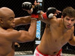 Patrick Cote striking with champion Anderson Silva