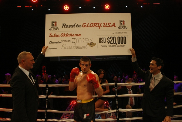 Twenty-four year-old Dustin Jacoby (center) was awarded a $20,000 grand prize check by GLORY Ambassador Cor Hemmers (left) and retired legend Frank Shamrock (right)