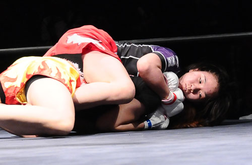 An 18-year old MIZUKI calmly snapped on this rear naked choke to improve her pro MMA record to 5-1
