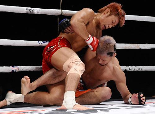 "ISAO (top) defeated Yoshiaki ""Bancho"" Takahashi via split decision to improve his MMA record to 15-1-4."