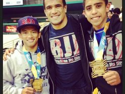 "Rubens ""Cobrinha"" with 2 Gold medal students - His son Kennedy on Cobra's left"