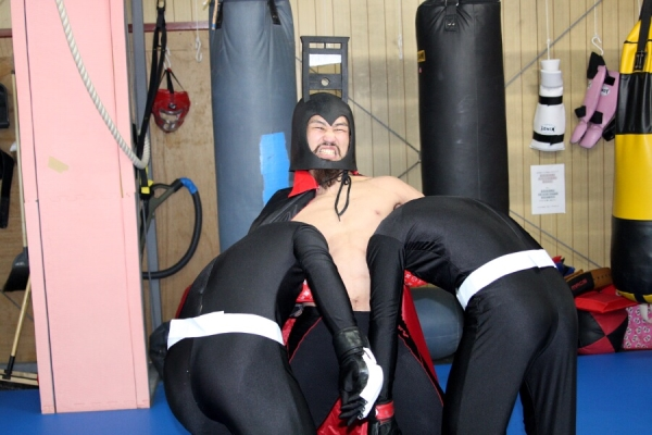 """Yo Saito, with a costume, showing his favorite """"guillotine choke"""" at the media work out held in Tokyo last week."""
