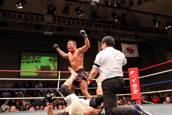 "Nobumitsu ""Tyson"" Osawa celebrates his win over Shinji Sasaki that earned him Shoot Pacific Rim 155 lbs title."