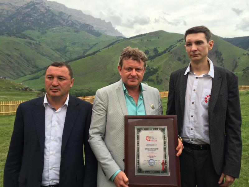 L-R: Akhmed Kotiev, Ingushetia Minister of Sports; Vadim Finkelstein, CEO & Founder of M-1 Global; Stanislav Kononev, Book of Records representative