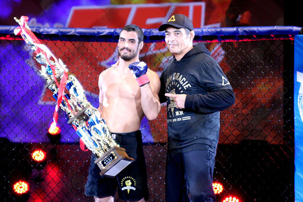 Kron Gracie (left) with his father Rickson Gracie after submitting Hyumg Su Kim in his pro MMA debut.
