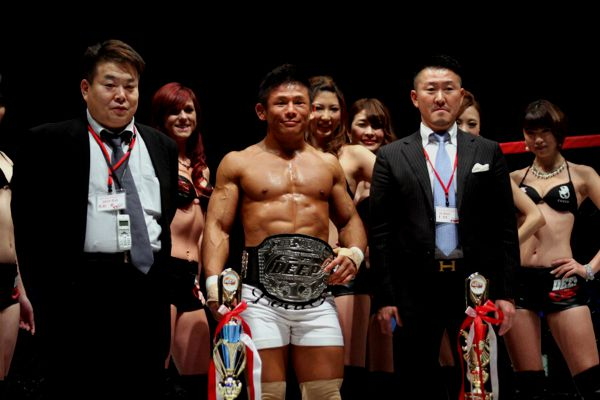 "Satoru Kitaoka (middle) controlled Yoshiyuki ""Zenko"" Yoshida for the entire three rounds with superior takedown and ground control to defend his DEEP lightweight title."