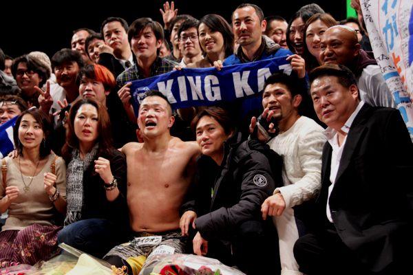 Kazuhiro Nakamura (center) with his supporters