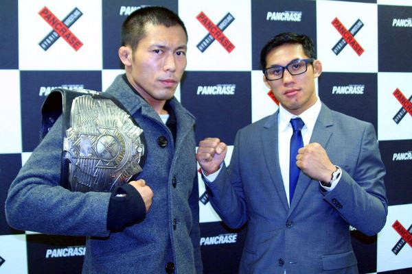 TAKUMI (left) and Nam Phan (right) at the title fight signing ceremony held in Tokyo on Monday