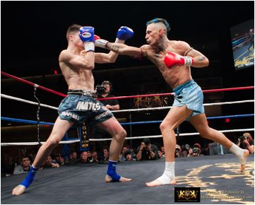 Kevin Ross (right) lands punch against Matt Embree at Lion Fight 13