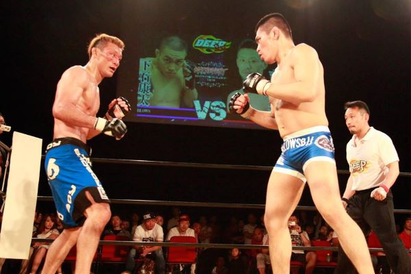 "In the headliner of DEEP OSAKA IMPACT 2015, UFC / Bellator veteran Yoshiyuki ""Zenko"" Yoshida (left) was dominated by a 27-year old Kota Shimoishi (right)"