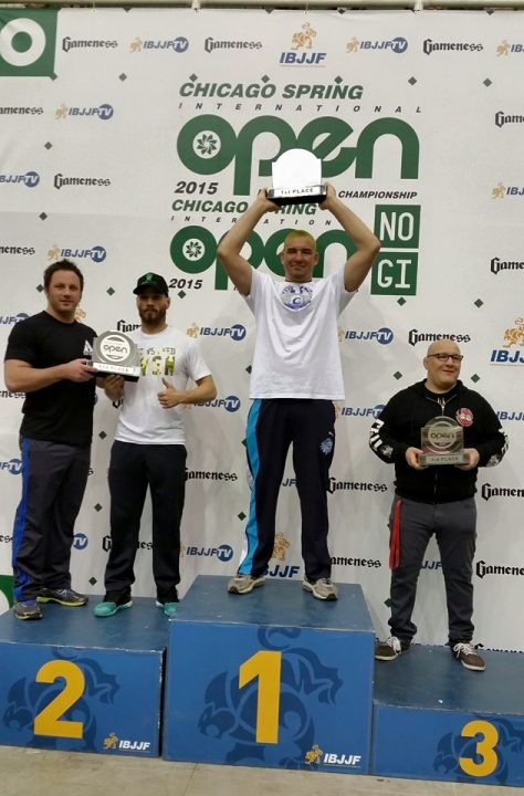 Comprido holds the Chicago Open Trophy