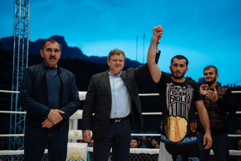 New M- Challenge welterweight champion Mural Abdulaev is crowned by M-1 Global president Vadim Finkelchtein