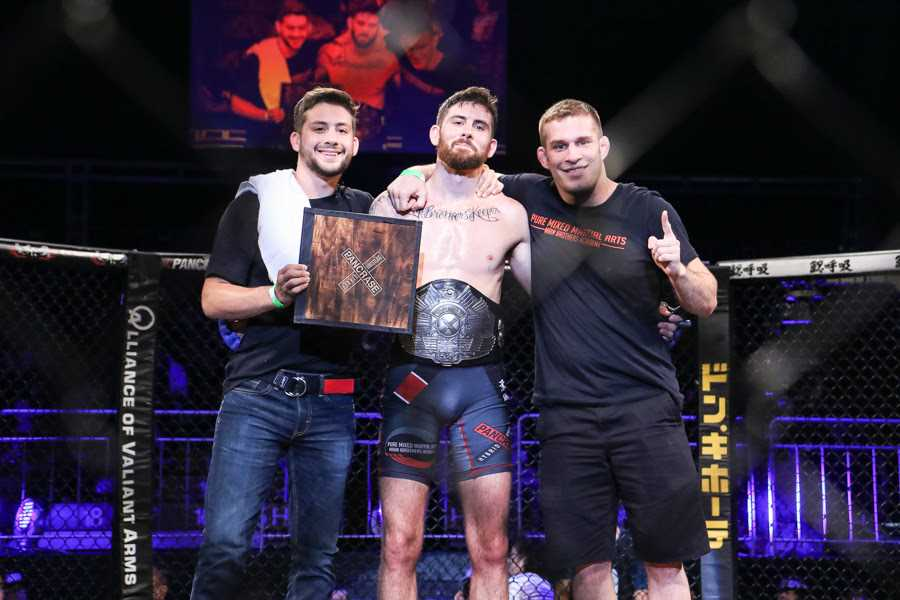After winning King of Pancrase title, Andy Main (center) expressed his wish to fight in the UFC